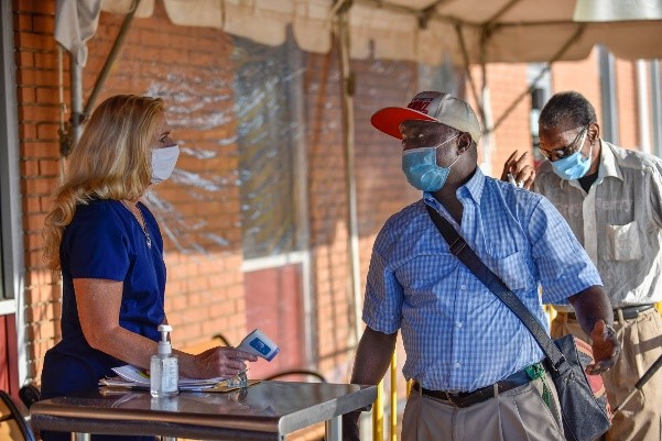 woman checking man for tempurature